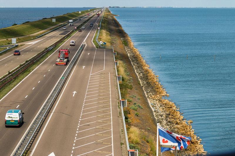 Tussen zee en meer. Afsluitdijk Day Direction Highway Road Road Marking Sea Water