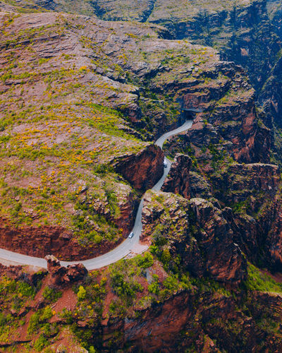 High angle view of road by rock formation
