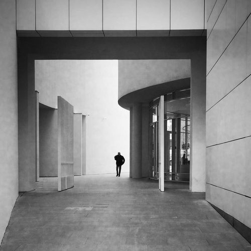 Man walking in building corridor