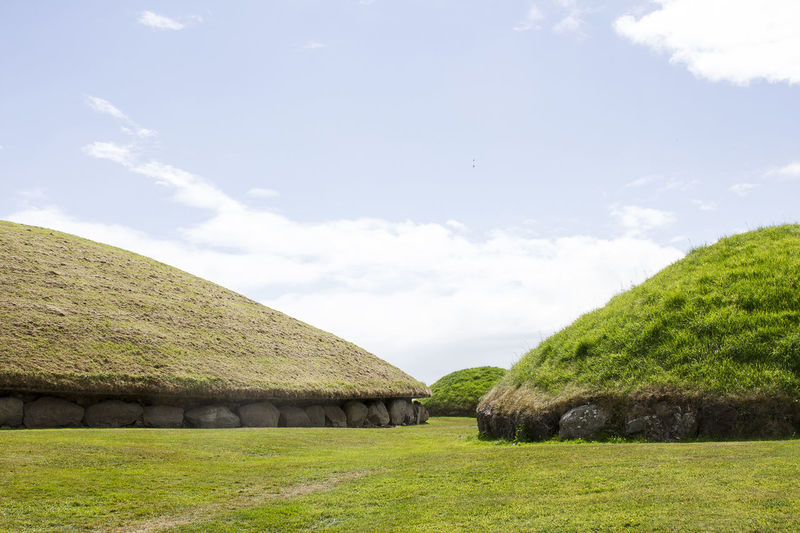Neolithic Newgrange tombs in Ireland Architecture Beauty In Nature Bru Na Boinne Built Structure Cloud - Sky Day Field Grass Green Color History Ireland Kells Landscape Nature Neolithic Neolithic Ireland Newgrange Outdoors Prehistoric Ruins Scenics Sky Tombs Tranquility Tree