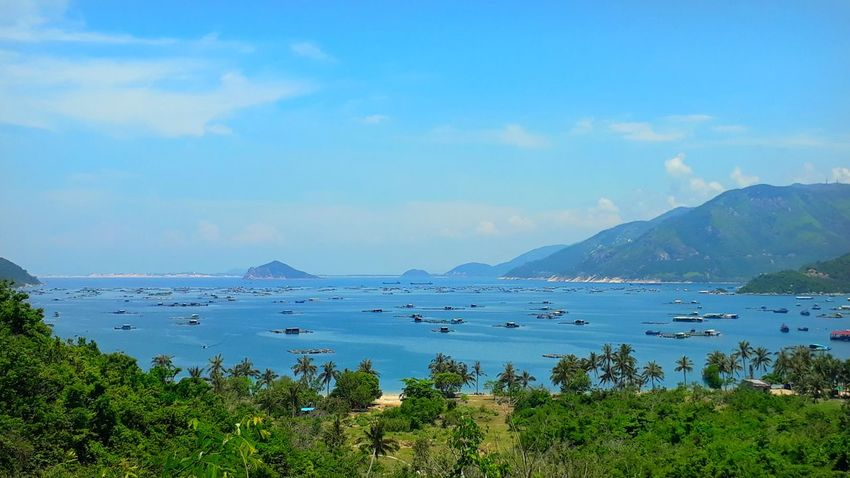 Vietnam Water Scenics - Nature Sky Landscape Sea Environment Mountain Nature Blue Travel Destinations Tranquility Tranquil Scene No People Day Lagoon Beauty In Nature Outdoors Travel Plant Land