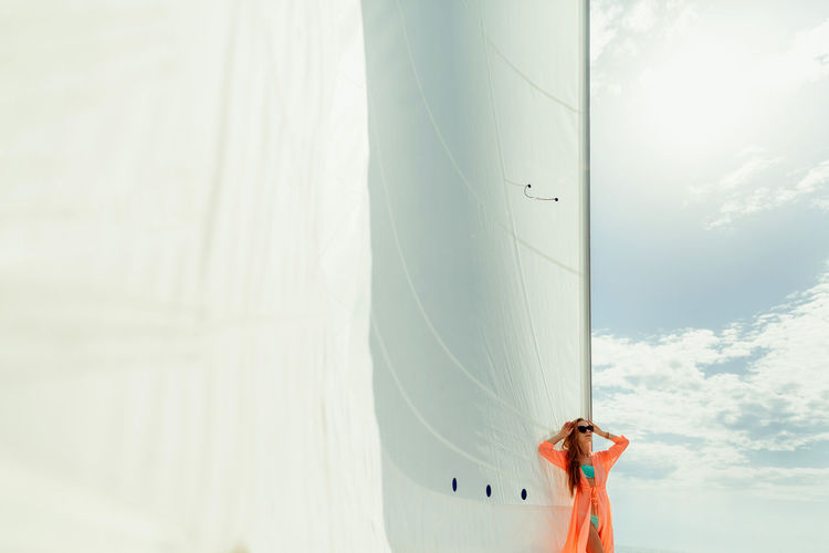 woman yachting on boat with sails. Big white sails Beautiful EyeEm Best Shots Luxurylifestyle  Mediterranean  Relaxing Sailing Ship Slim Travel Traveling Bikini Female Leisure Activity Luxury One Person Pareo Sail Sailing Sea Sexygirl Ship Summer Sunglasses Yacht Yachting Young Adult