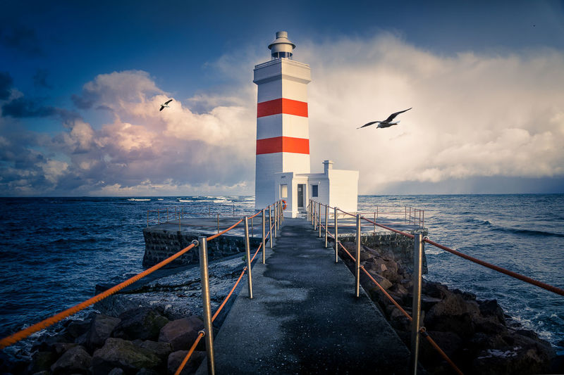 Beacon Coasting Iceland Lighthouse Rock Surf Wave Bay Coast Danger Gull Island Landmark Mud Flat Nautical Navigation Port Seagull Seemann Shipping  Sinew Sky Tower Water Waves