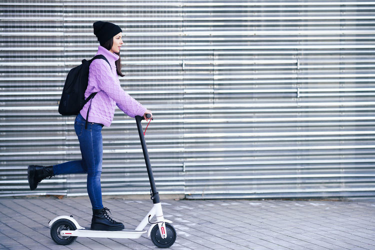 Full length of woman riding skateboard