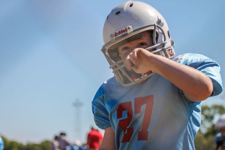 ChildhoodFootballPeeweeChildhood Lifestyles Real People Recreational Pursuit Close-up Selective Focus Sports Game Time  Boys Here Belongs To Me Showing Imperfection The Portraitist - 2017 EyeEm Awards