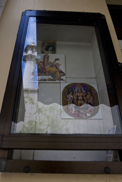 Sri Mariamman Temple Window with reflection of Sultan Mosque Tower, Singapore Architecture Curtain Day Ganesha Hindu Gods Indoors  Mosque Tower No People Reflection Singapore Temple Vishnu Window First Eyeem Photo