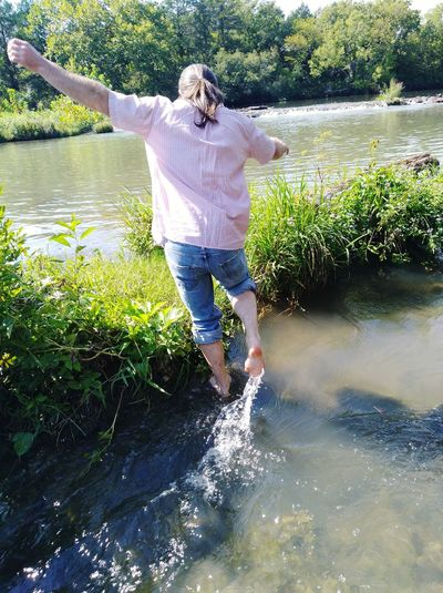 Blue River Dramatic Sky Clouds And Sky Countryside Adventure Balance Love Man Water Ankle Deep In Water Full Length Standing Happiness Sky Casual Clothing Splashing