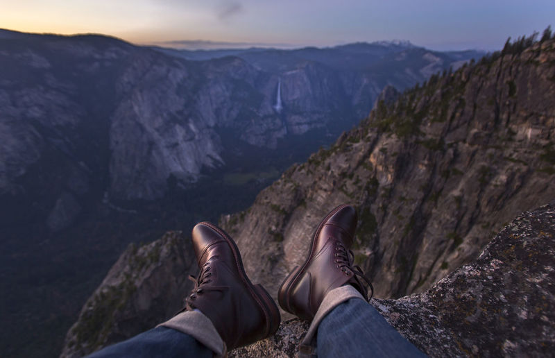 Adventure Beauty In Nature Boots California Cliff Day Fashion Human Body Part Human Leg Leisure Activity Lifestyles Low Section Men Mountain Nature One Person Outdoors Personal Perspective Real People Rock - Object Scenics Shoe Standing Style Yosemite National Park