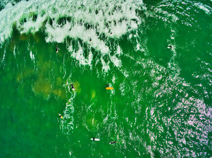 Surfers on the water view from above, i love the eagle eye in drone photography. Water Nature Green Color Swimming High Angle View Waterfront Outdoors Motion Surfers View From Above EyeEm Selects EyeEm Best Shots Edited With Luminar Waves Ocean Eagle View Surf Looking Down Drone Photography Drone  Surfboard Rocks Seaside Day Daytime Amazing View Calm Relaxing Waves, Ocean, Nature Waves Rolling In Water Surface Water Sport