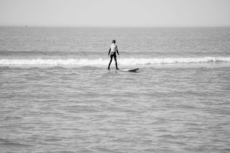Sea Water Horizon Over Water Real People Sky Sport Men Waterfront Beauty In Nature People Leisure Activity Horizon Aquatic Sport Lifestyles Extreme Sports Paddleboarding Scenics - Nature Wave Adventure