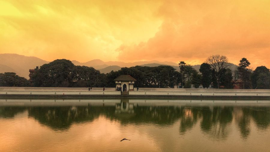 Sunset Yellow Sky Water_image Water_mirror Mirror Clouds Temple Nepal Bhaktapur World_heritagr_site Siddhapokhari Nepal_travel Mobile Photography Samsung Galaxy S5