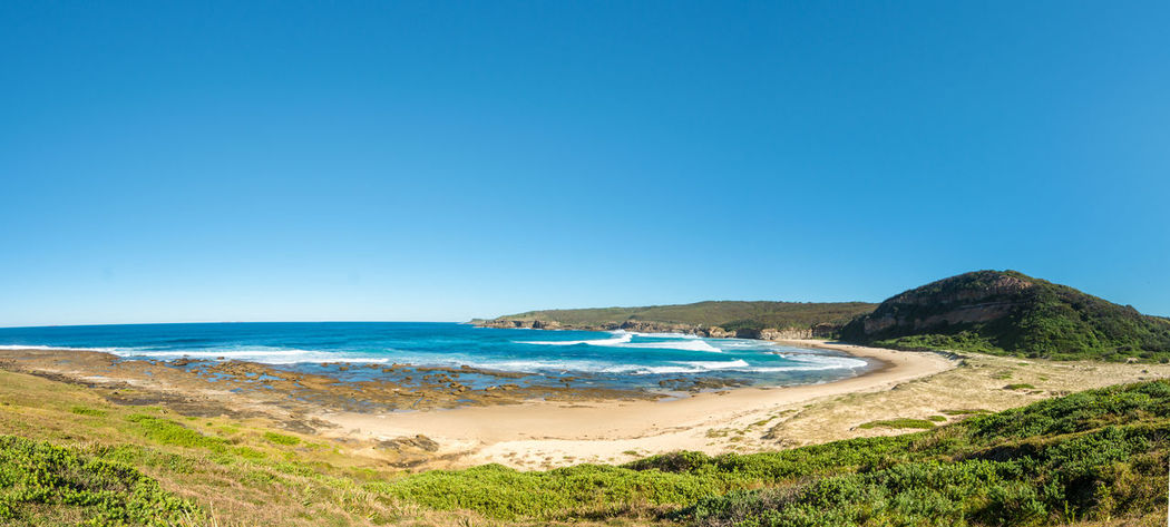 Panorama of a deserted beach, Catherine Hill Bay on the New South Wales Central Coast, Australia. Water Beach Land Sea Sky Beauty In Nature Scenics - Nature Clear Sky Sand Tranquil Scene Nature Tranquility Blue Outdoors Copy Space Day Horizon No People Horizon Over Water Non-urban Scene Bay Turquoise Colored