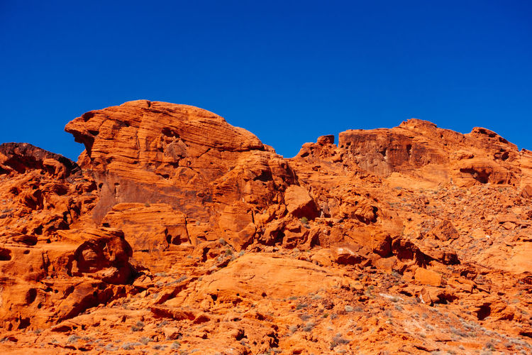 Low angle view of rock formation against clear sky at valley of fire state park