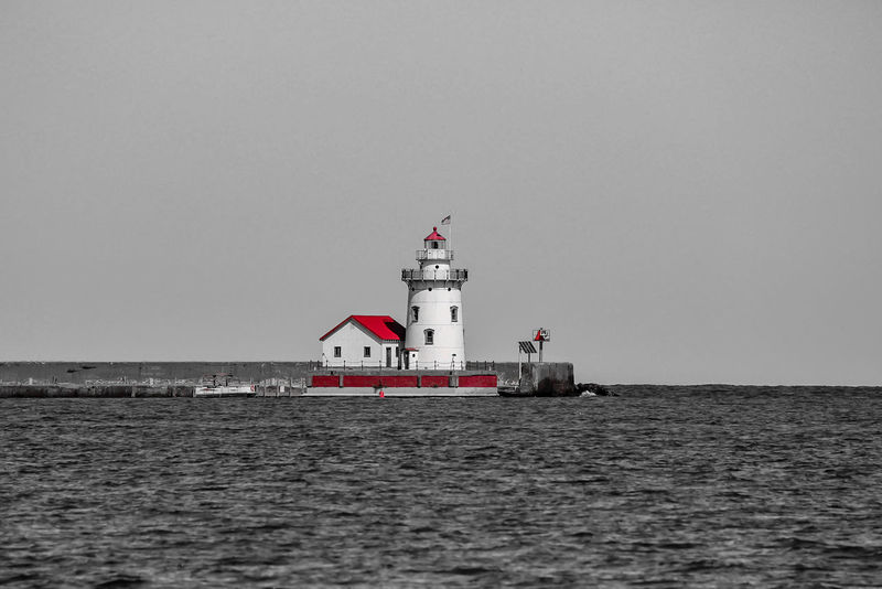 lighthouse in northern Michigan Michigan Architecture Beauty In Nature Building Exterior Built Structure Clear Sky Day Direction Guidance Horizon Over Water Lighthouse Nature Nautical Equipment No People Outdoors Protection Safety Sea Sky Water Waterfront