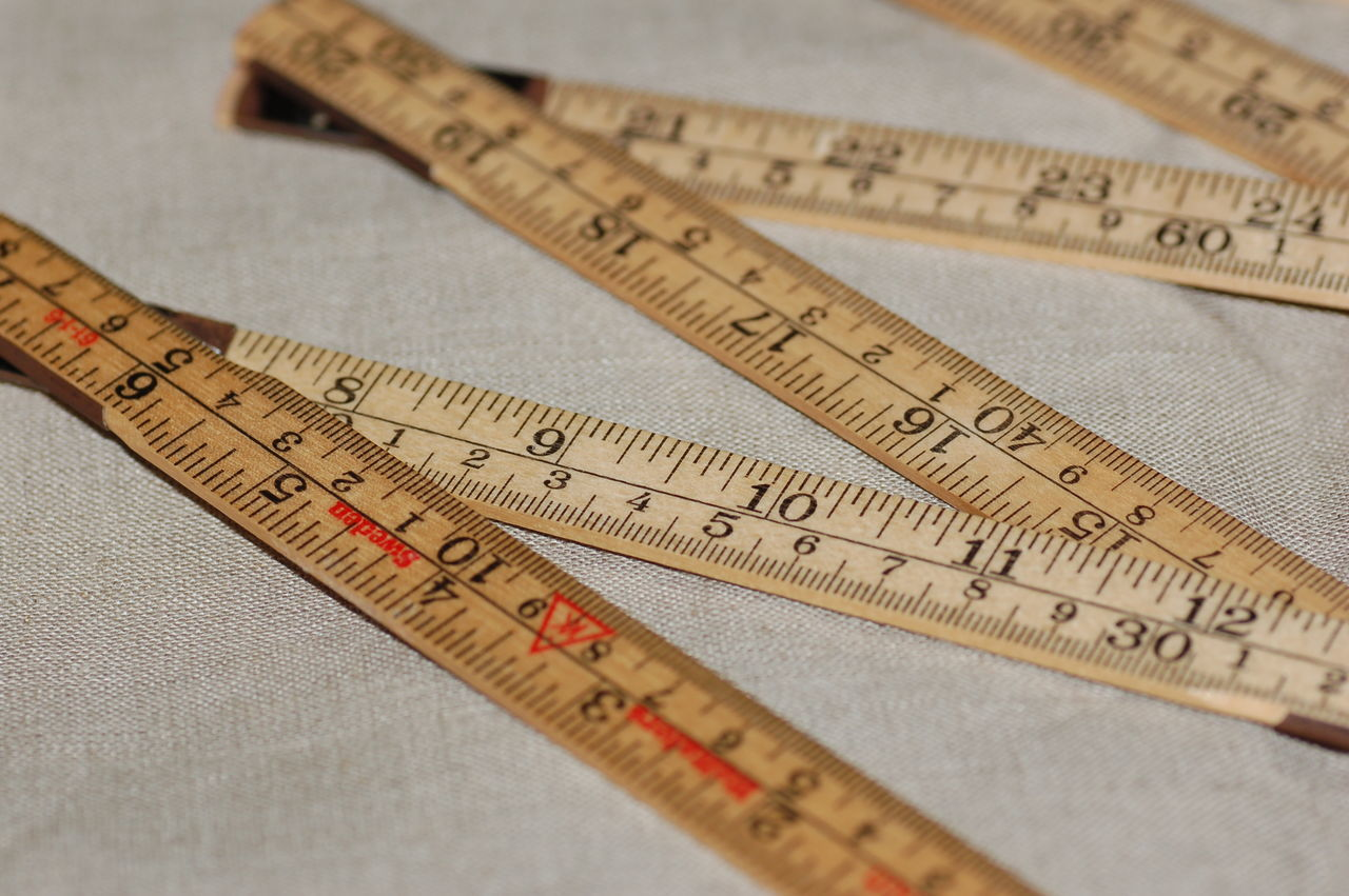 High Angle View Of Tape Measure On Fabric