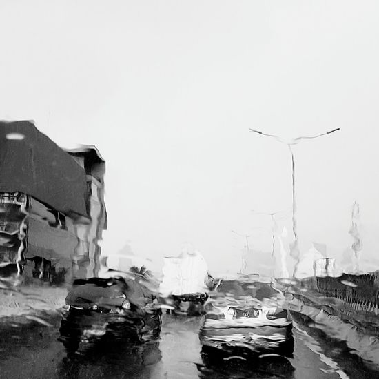 Raining... Extreme Weather Outdoors City Day Car Rain Rainy Days Raindrops Rainy Day Blackandwhite Photography Blackandwhitephotography Jakarta Black And White Jakarta Indonesia Samsungs7edge Blackandwhite