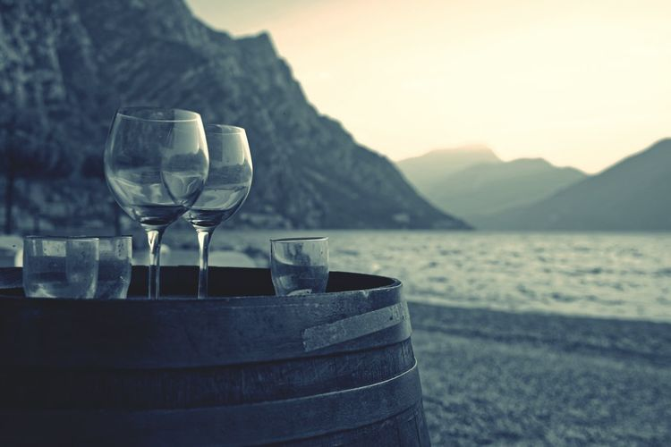 Drinking Glasses On Wine Barrel By The Beach