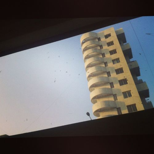 Random click through a moving PMT Bus Paudroad Frame Window Highrise Pune Street Photography Kothrud  Puneinstagrammers
