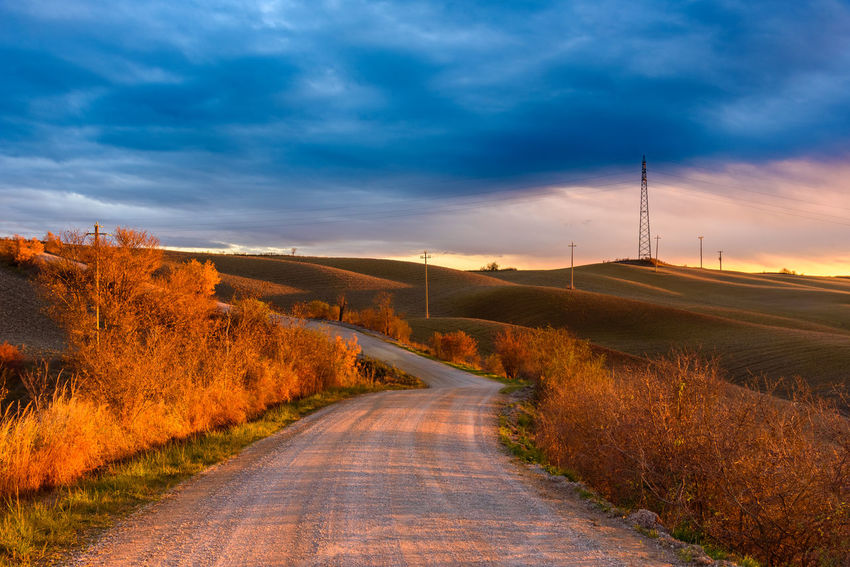 Crete Senesi Torre A Castello Tuscany Countryside Beauty In Nature Cloud - Sky Day Electricity Pylon Field Grass Landscape Nature No People Outdoors Road Rural Scene Scenics Siena Sky Sunlight Sunset The Way Forward Tranquil Scene Tranquility Tree