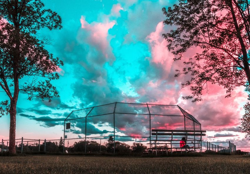 Sunset Sky Cloud - Sky Nature Arts Culture And Entertainment Outdoors Architecture Smoke - Physical Structure Incidental People Tree Multi Colored Night Built Structure Building Exterior Plant Motion Boundary Land Fence Blue