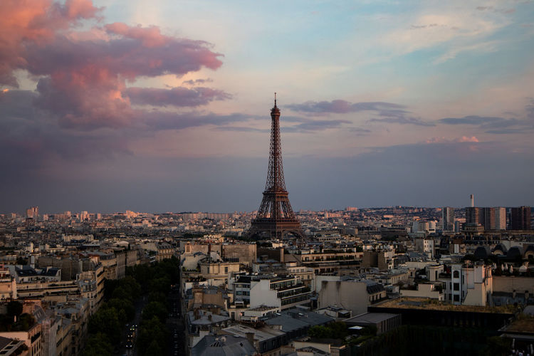 Eiffel Tower Architecture Building Building Exterior Built Structure City Cityscape Cloud - Sky Crowd Crowded Nature Office Building Exterior Outdoors Residential District Sky Skyscraper Spire  Sunset Tall - High Tourism Tower Travel Travel Destinations