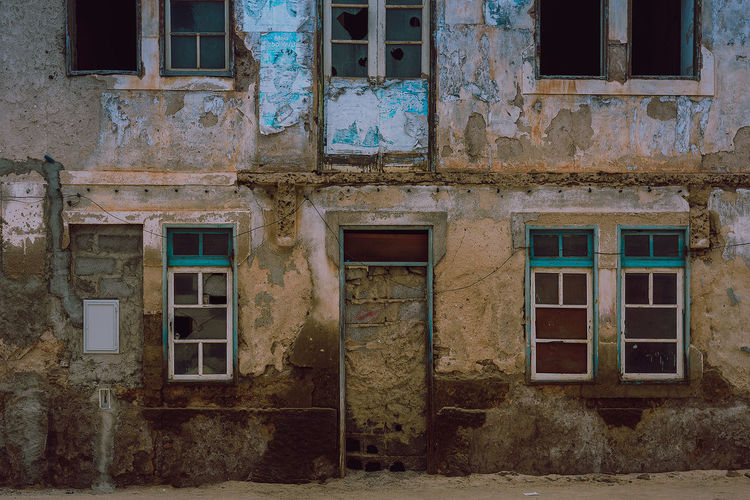 Abandoned building in Cape Verde in Africa. African Abandoned Architecture Bad Condition Blue Building Exterior Built Structure Damaged Day House No People Outdoors Residential Building Window