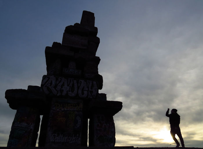 Sky Text Silhouette Western Script Real People Photography Themes Leisure Activity Outdoors Standing Sculpture Creativity Taking Photos Taking Pictures Taking Photo Gopro Scale  David And Goliath Discovery Exploring Photographing Photographer Shooting Photos Outdoor Photography Halde Rheinelbe One Person