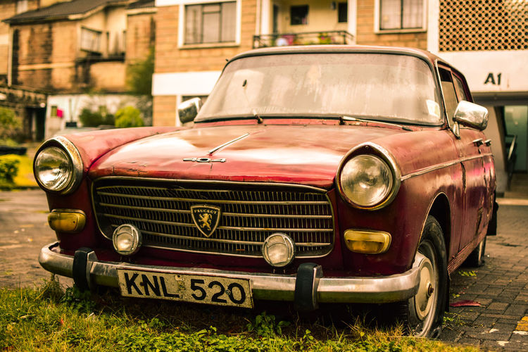 Old vintage Peugeot car Architecture Building Exterior Car Day Headlight No People Old-fashioned Outdoors Red Retro Styled Transportation Vintage Vintage Cars The Still Life Photographer - 2018 EyeEm Awards