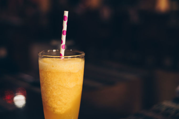 healthy and delicious fresh juice in a tall glass with polka dot paper straw Drink Food And Drink Refreshment Glass Drinking Glass Straw Close-up Drinking Straw Focus On Foreground Food Freshness Cold Drink Sweet Food Temptation Citrus Fruit Passion Fruit Ginger Backgrounds Copy Space Polka Dot Isolated Object Juice Orange Toned Image My Best Photo
