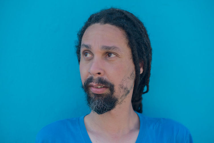 Kind of blue Adults Only African Beard Bearded Blue Close-up Colored Background Copy Space Dreadlocks Dreads Front View Headshot Human Body Part Locs Men One Man Only Only Men People Portrait