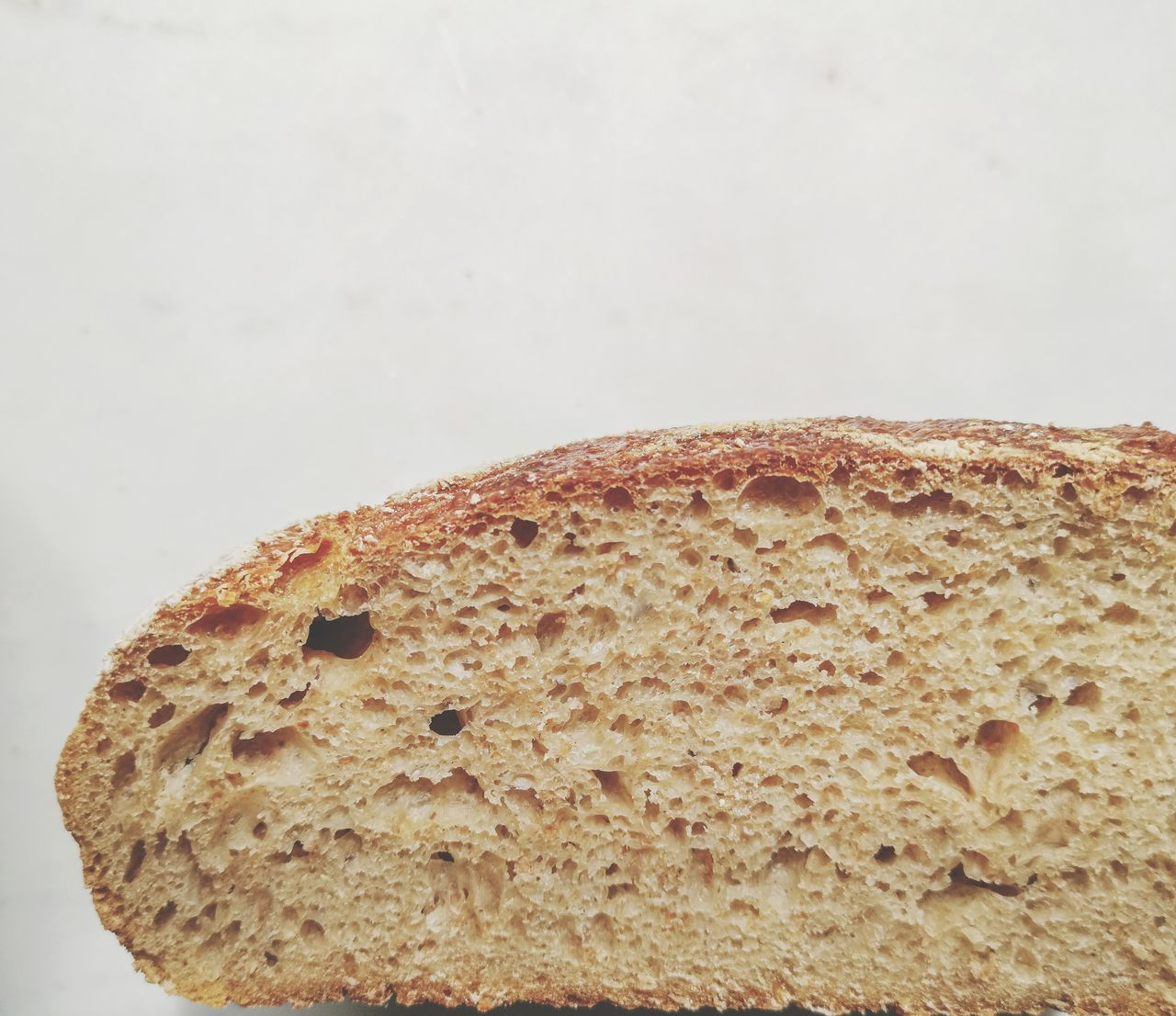 CLOSE-UP OF BREAD ON WHITE TABLE