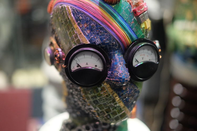 Close-up of circuit board head with pressure gauge eyes