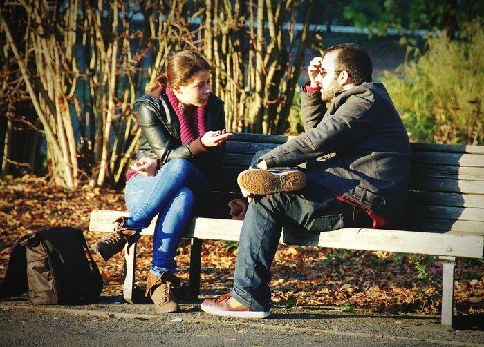 Sitting Two People Sunlight Friendship Women Leisure Activity Outdoors Sunshine Bench Cambridge Christs Piece Park City Talking Conversation