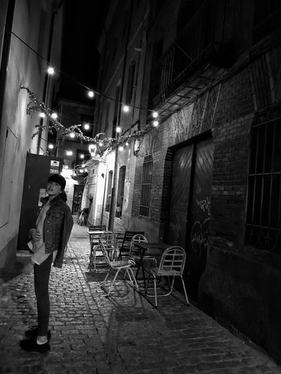 Building Exterior Architecture Night Illuminated One Person Real People Street Light Outdoors City Blackandwhite