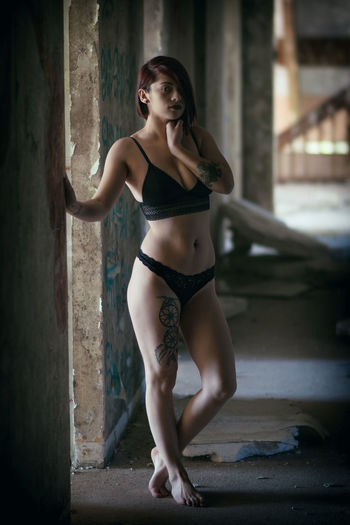 Portrait of young punk wearing bikini at abandoned building