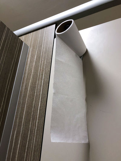 Low angle view of paper hanging on wall