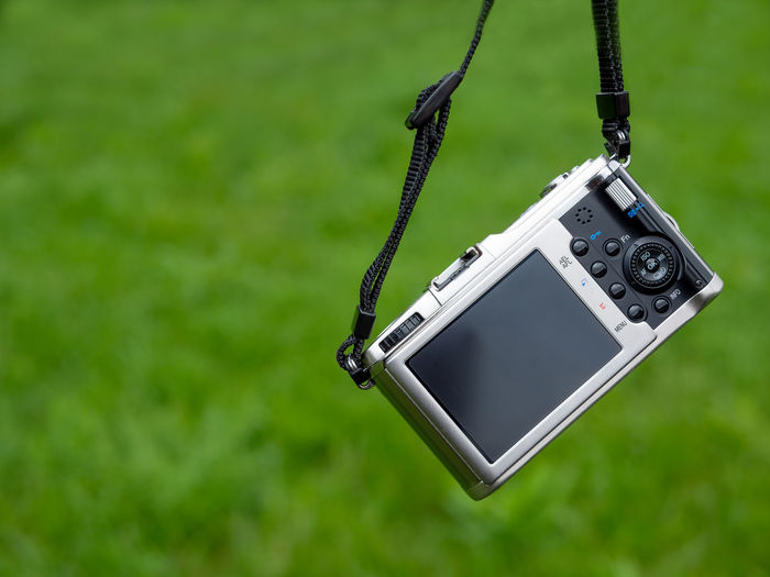 Close-up of camera hanging on plant