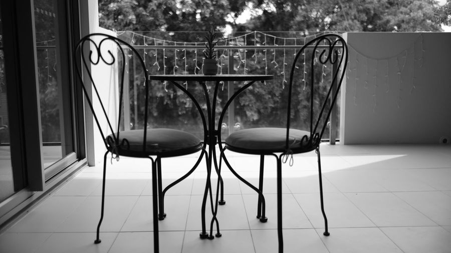Balcony Balcony View Black & White Black And White Blackandwhite Blackandwhite Photography Chair Day Empty Full Frame Monochrome No People Outdoor Furniture Outdoors Seat Tree