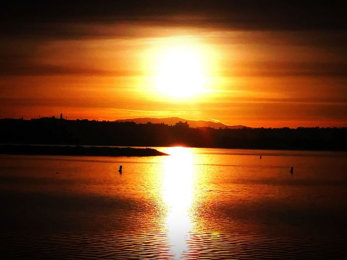 """ The Mirrored Sun "" My Life My Soul  Home Sweet Home Bay San Diego Life Salty Crew Reflection Sun Beauty In Nature Silhouette Tranquility Tranquil Scene Sunlight Sea Sky Outdoors Dramatic Sky"