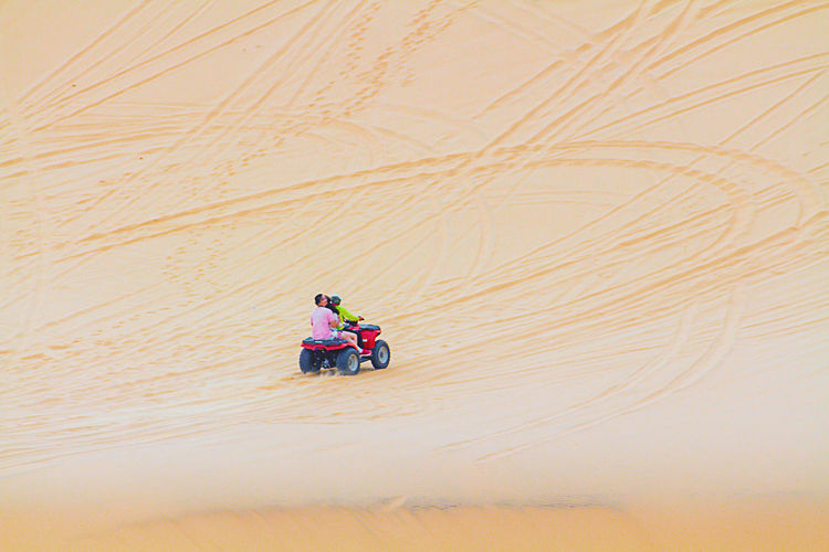 Sand Dunes (White Desert) At Mui Ne, Vietnam. Atv Muine, Vietnam  White Desert, Vietnam Adult Climate Day Environment Full Length High Angle View Land Land Vehicle Landscape Lifestyles Men Mode Of Transportation Nature Real People Riding Sand Sand Dune Sitting Transportation Travel Women Mode Of Transport Friend Desert Relaxing Moments Vehicle Motorcycle