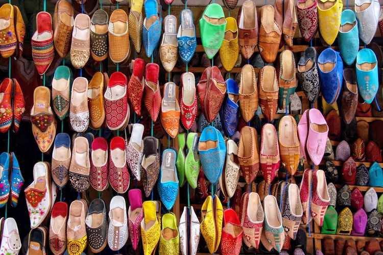 Full frame shot of colorful shoes for sale at market