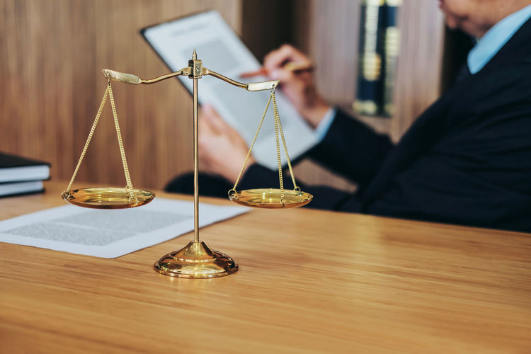 One Person Indoors  Weight Scale Wood - Material Business Human Body Part Scale  Holding Men Adult Occupation Business Person Balance Accuracy Courthouse Counselor Fairness Barrister Notary Gavel Judgement Lawyer Legislation Verdict Inheritance