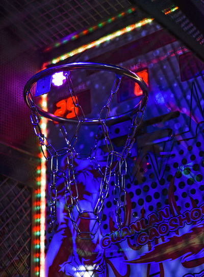 Basketball Hoop Arcade Games Nightlife Indoors  Illuminated Night No People Glass Close-up Lighting Equipment Household Equipment Glass - Material Focus On Foreground Blue Still Life Transparent Arts Culture And Entertainment