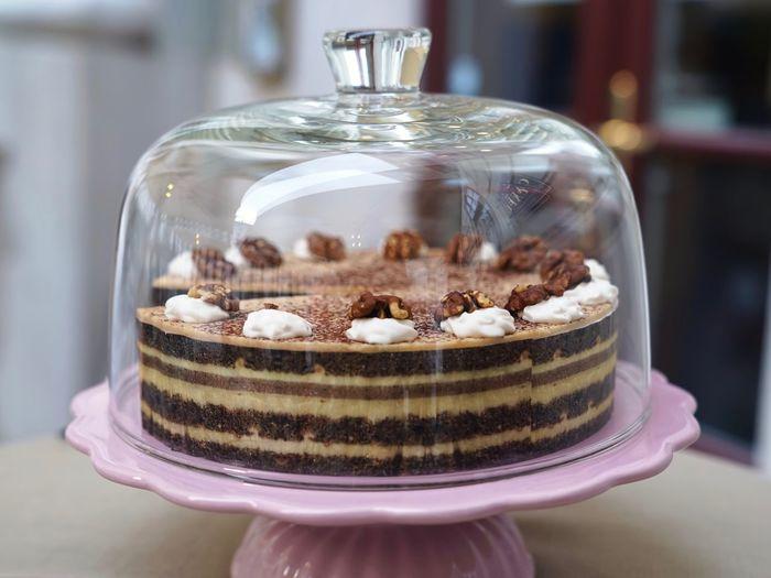 Close-up of cake under a cake dome