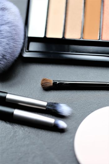 Black Color Technology Writing Instrument Selective Focus Choice High Angle View Group Of Objects Close-up Table Make-up Make-up Brush Indoors  Still Life Eyeshadow Computer No People Beauty Product Body Care And Beauty Variation Blush - Make-up
