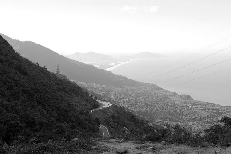 Hai Van Pass, Vietnam Beauty In Nature Black And White Black And White Photography Day Driving Fog Hai Van Hai Van Pass Hairpin Turns High Angle View Mist Moped Mountain Mountain Range Nature Non-urban Scene Outdoors Physical Geography Remote Scenics Solitude Tranquil Scene Tranquility Vietnam Water