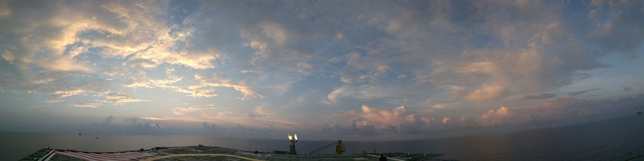 Offshore sunset panorama Travel Outdoors Sunset Nature Beautiful Sky That's Me Sky And Clouds Scenics Beauty In Nature No People ArtWork Cloud - Sky Hello World Dramatic Sky Day Travel Destinations Tourism City Night Cityscape Photographer Water Backgrounds Orange Color