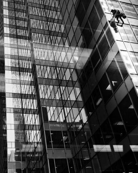 Look up aArchitecturesStreetphotographyCChicagobBlackandwhitesSkyscraperwWindowWWindow WasherwWasher