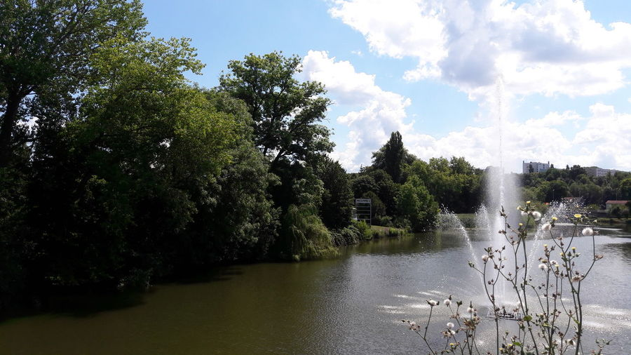 Montbéliard, France Water Trees Fountain Water Reflections White Clouds And Blue Sky Colors Of Summer