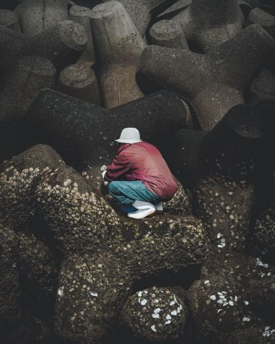 An old woman picking seaside clams on the rising of the day. Picking Hojo  Ehime Japan Clam Seaside High Angle View Red No People Day Outdoors Water Nature Close-up